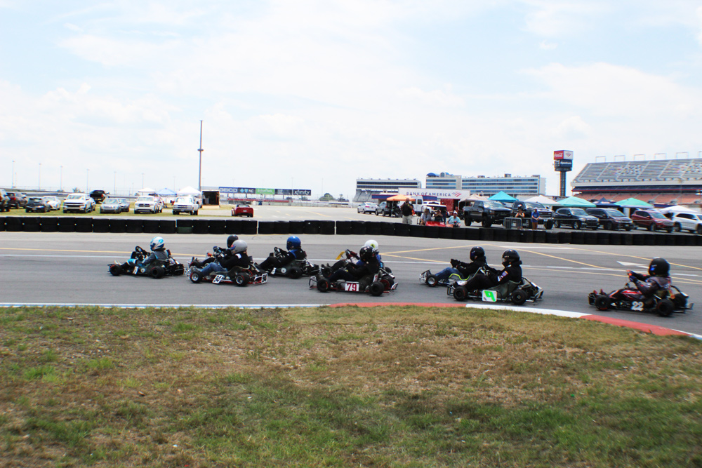 Tyler Swann leads the Vintage Medium field out of turn 1