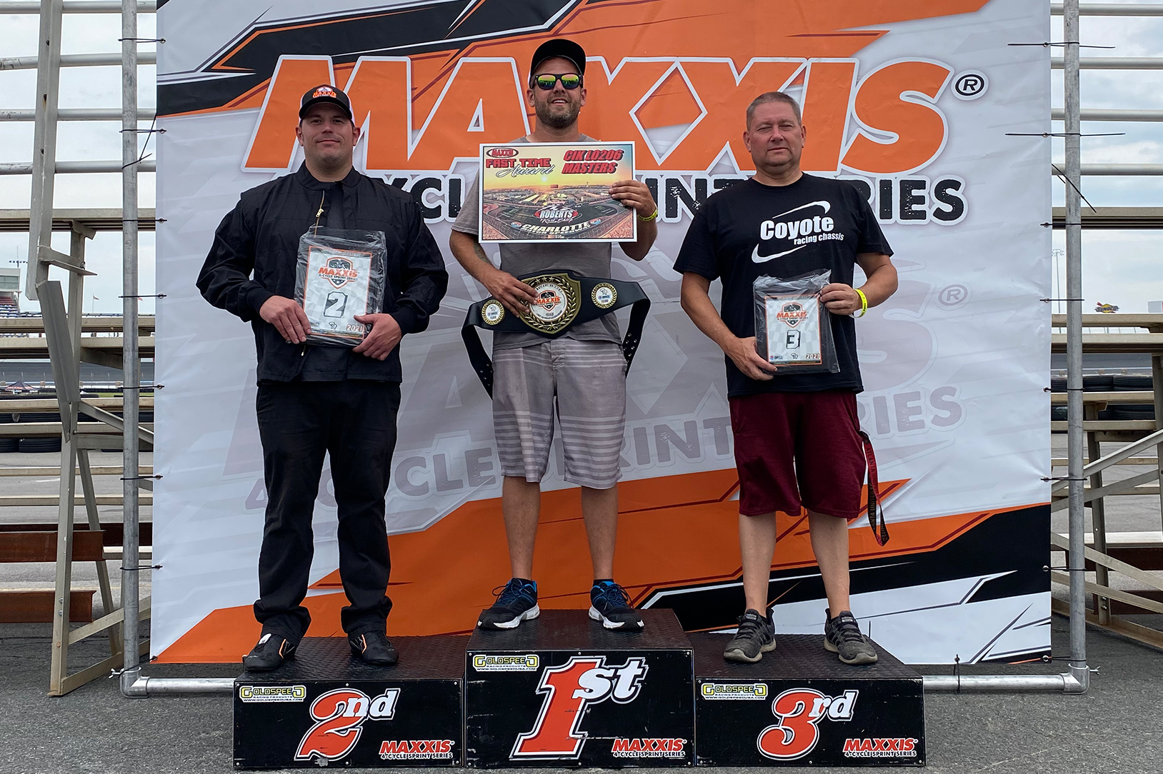 Eric Fagan atop the Masters podium over Tim Skinner and James Inscoe
