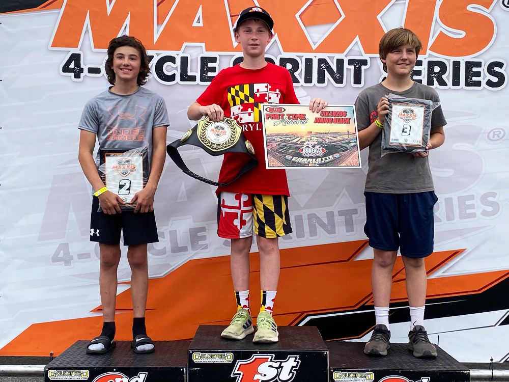 Brady Atwood atop the Charlotte Maxxis podium in June